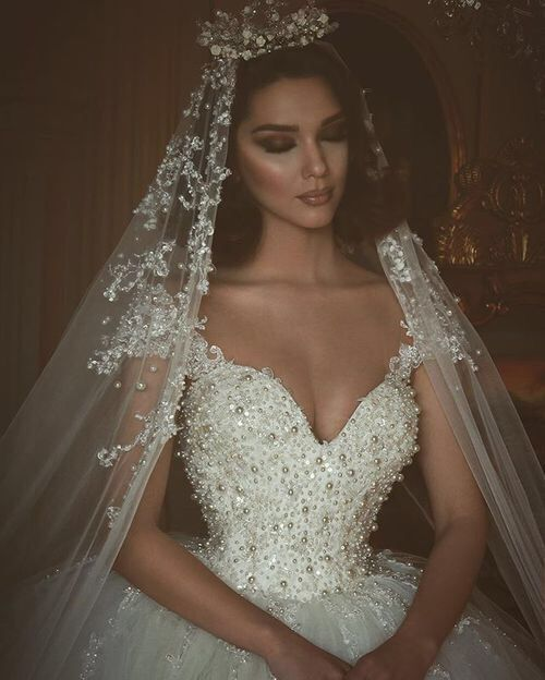 Swarovski crystal wedding dresses are amazing. This heavily beaded bridal gown is fit for a Princess. you can have custom #weddingdresses like this recreated by our American based dress design company for a great price. We have offered brides affordable custom bridal gowns & #replica wedding dresses since 1996. Email us directly for pricing on any dress that may be out of your price range to see if we can help.