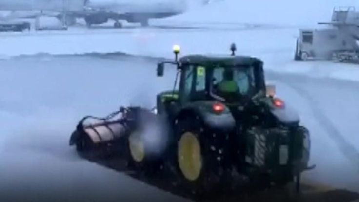 Heavy snow hits parts of the UK including Scotland, where Glasgow airport suspended flights.
