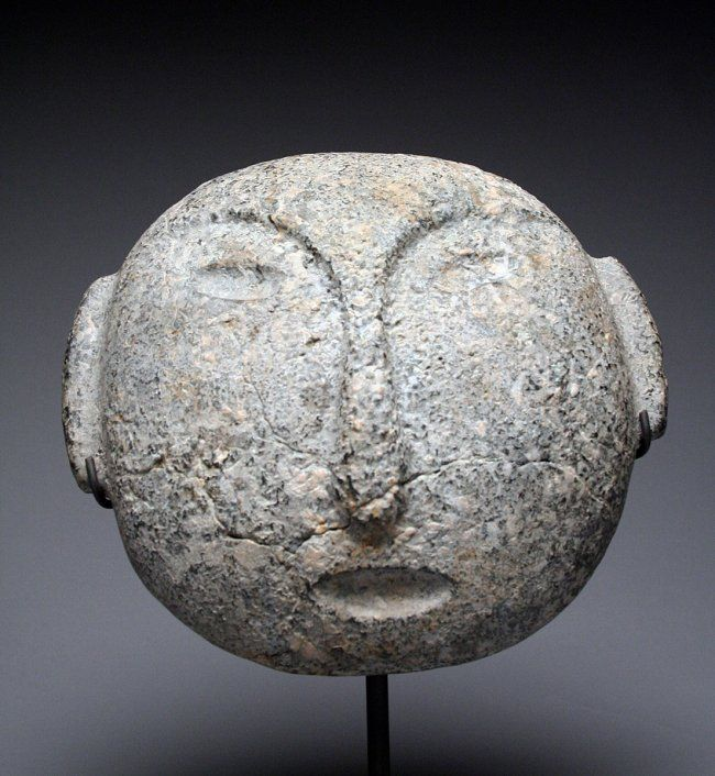 Rare Mapuche Stone Mask. Chile, Ca. 1500 CE. Carved stone mask of a man's face.