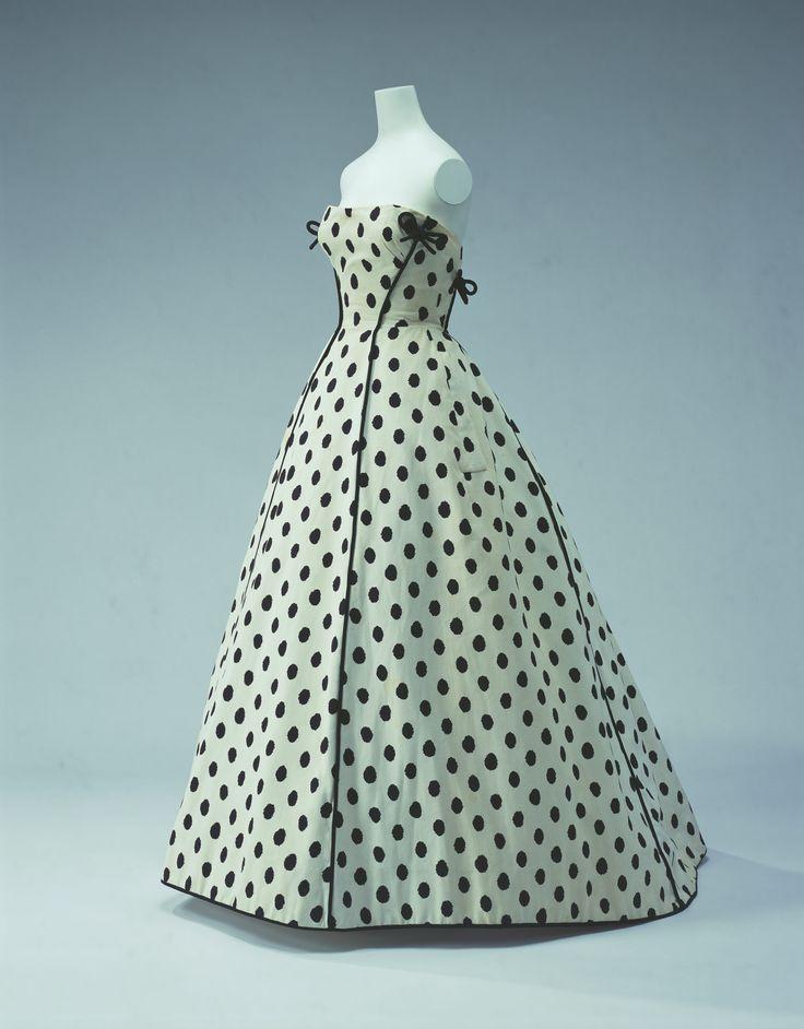 Evening Dress c. 1953  Designer:Jacques Fath  Brand:Jacques Fath  Label:  JACQUES FATH PARIS  Material:  White cotton piqué printed with black polka-dot pattern; black piping ornamentation.