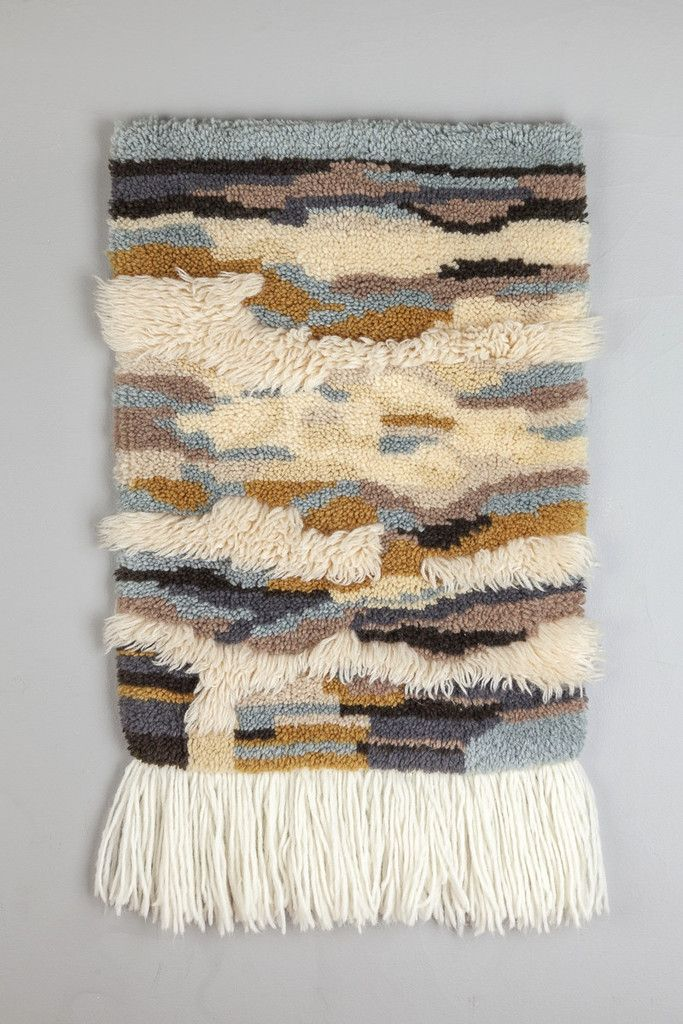 Beautiful 1970's handmade woven wall hanging. Amazing color neutral color scheme with pops of blue and black. Handmade with yarn by hand. Great condition. Measurements: Length - 36'' Width - 21''