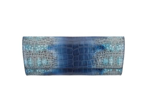 The Ava clutch is a celebration of craftsmanship and color. Lined in luxurious leather and suede, and finished with internal pockets, this beautiful piece is the perfect way to add fun to your evening.