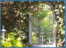 Give your garden an enchanted feel, and make it seems a little bigger by adding a mirror.