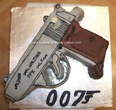 Homemade Gun Cake: My Stepdad is a James Bond fan so for his birthday I made this Walther PPK cake, Bond's weapon of choice!  I made two cakes in loaf tins, and filled them: Manly Cakes, Weapon Cake, Groom Cakes, Cakes Cupcakes, Gun Cakes, Bond S Weapon, Birthday Cakes, Birthday Ideas