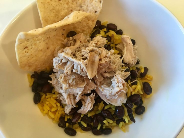 Super easy crockpot recipe for Mojo Chicken with beans & rice! Using Goya Mojo Criollo marinade for an easy, mexican meal
