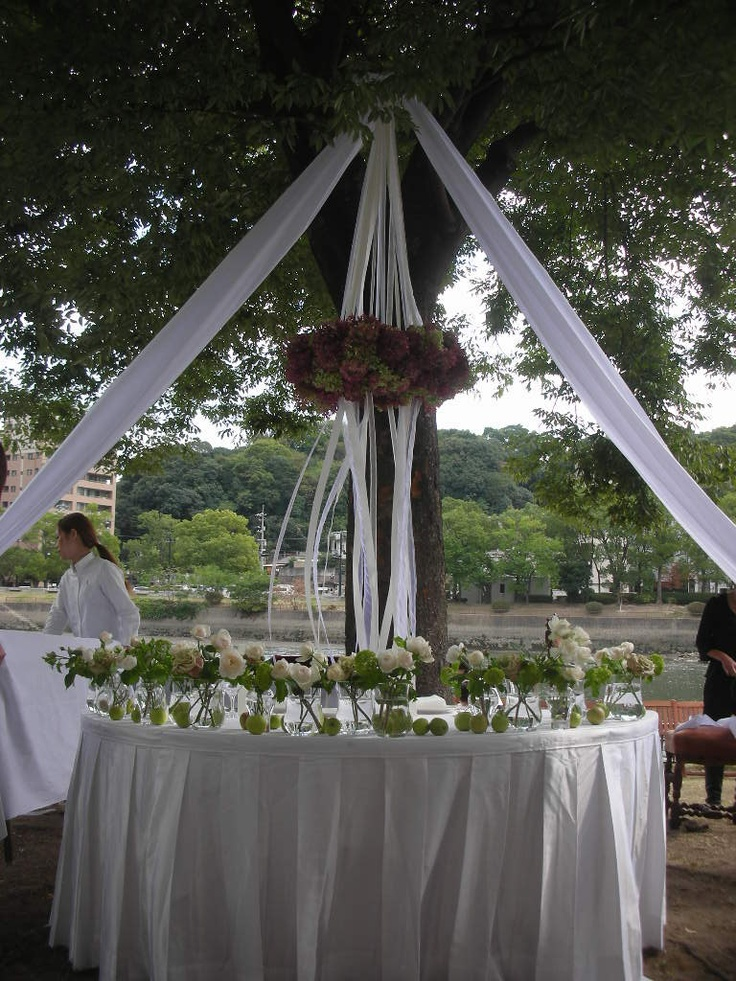 chandelier and bride's table under the tree