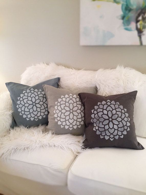 These are handmade decorative pillow covers from Salem, OR! Each pillow is individually cut, sewn, and stenciled. Size: Designed to fit an 18x18 pillow form Fabric: 56% linen, 44% rayon Color: Aloe, Charcoal, or Natural Linen Stencil: White dimensional permanent fabric paint Design:
