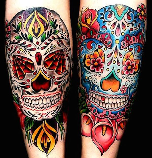 This is one unique sugar skull tattoo since it's got a head band andused daisies as the flower. Description from tattoo-models.net. I searched for this on bing.com/images