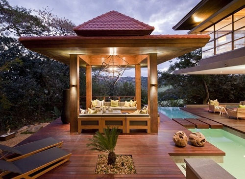 """""""SGNW House is modern two-storey house and it is located in Zimbali, South Africa. The house is designed by Metropole Architects. The house design is perfect combination between stone, wood and glass."""""""