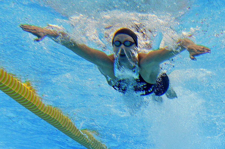 2012 London Olympics | Day 1 - U.S. swimmer Dana Vollmer competes in the women's 100m butterfly semi-final swimming