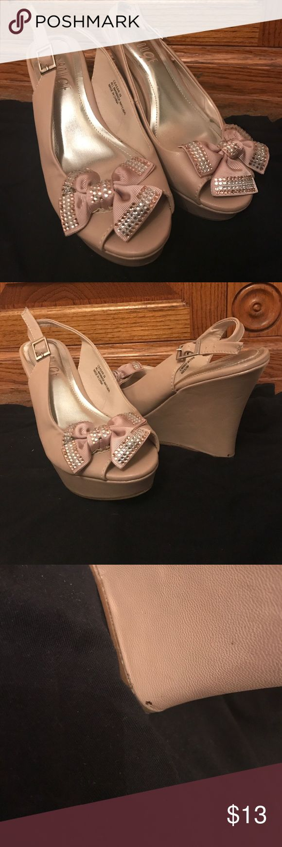 Cream bow studded wedges. Cream wedges worn. Only one mark on the bottom shown in picture. The shoe strap feature a bow with gold and white rhinestones Shoes Wedges