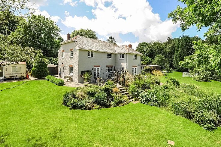 A delightful 4 bedroom detached home in a sheltered valley setting. The property has an established cattery and a holiday letting static caravan. The clients also offer bed and breakfast accommodation in the main property. You can view more properties like this at Johndwood.co.uk  #House #Green #Cornwall