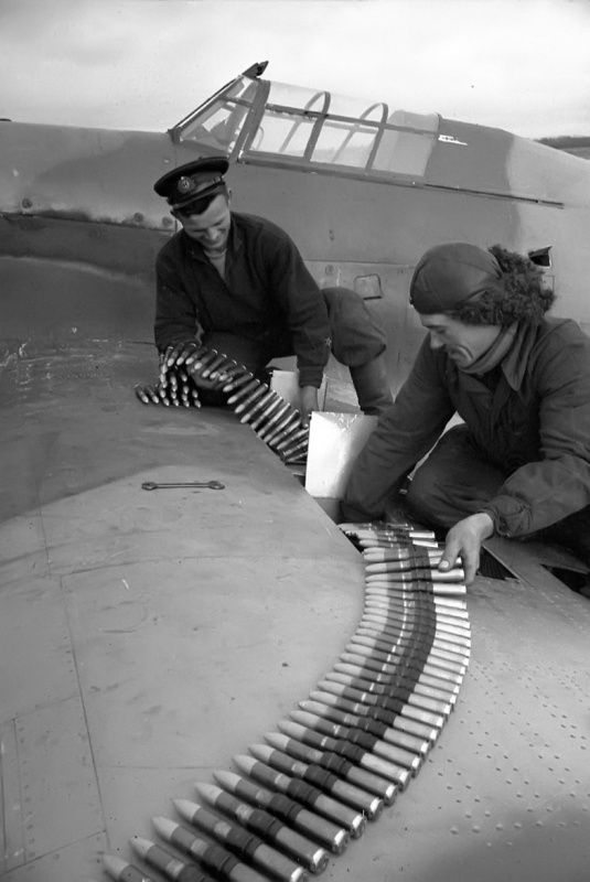 Soviet mechanics loading a 20-mm cannon ShVAK of a Hurricane belonging to the 72nd Fighter Aviation Regiment protecting the Northern fleet bringin supplies to Murmansk. If the fighter aircraft was British made, the ShVAK were produced in Russia, and mounted on many different types of aircrafts.