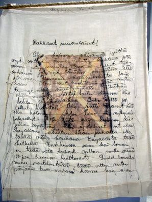 Installation is made of my familys old textiles. Old photographys and letters  tell the story of war and tragedy of leaving home. Phototransfer, machine embroidery Photographed in Salo artmuseum, Finland