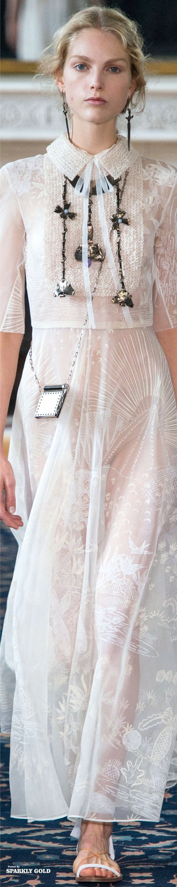 Using black accessories over a completely white outfit   Valentino Spring 2017 RTW