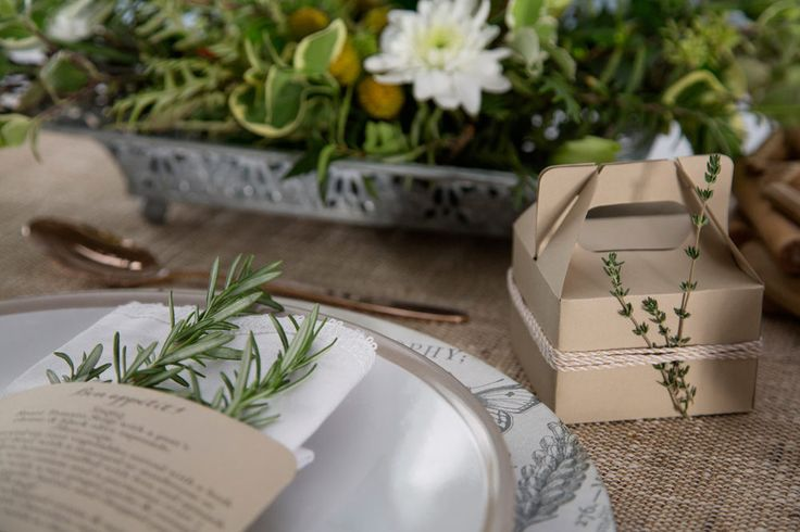 Kraft paper box with thyme and twine details. Rustic herb wedding theme. Photo by Rikki Hibbert. Flowers by Diamonds & Pearls Event Styling.