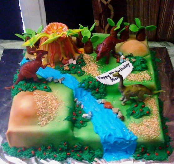 dinosaur cake- use plastic Dinos and trees- that doesn't sound too bad...could use rice krispees too