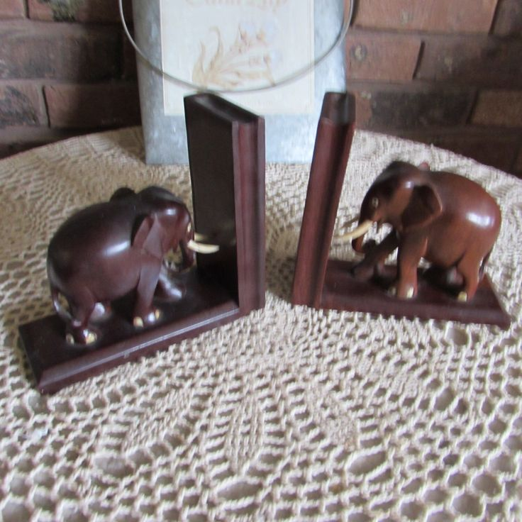 Cute Wood Carved Elephant Bookends. by JunkyardDog42 on Etsy https://www.etsy.com/listing/497103219/cute-wood-carved-elephant-bookends