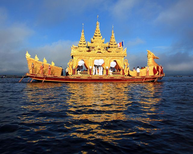 Boat Carrying Buddha Statues by Rob Kroenert on Flickr - A ceremonial boat carrying four sacred Buddha statues on Inle Lake in Burma (Myanmar)
