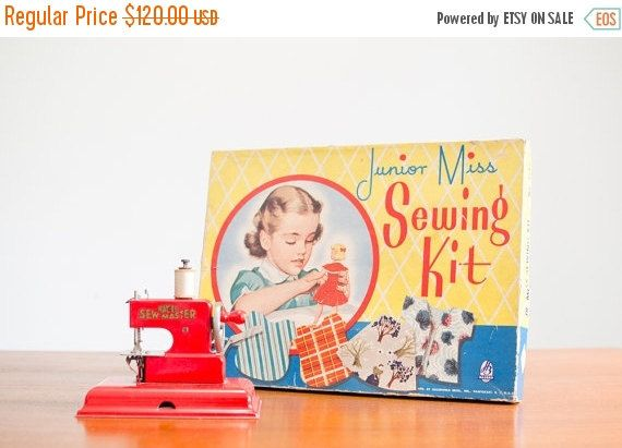 We have paired a German KAY-an-EE sew master red childs sewing machine with this Junior Miss Sewing Kit. The sewing machine is made of pressed
