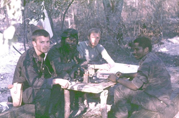Angolan and Soviet officers conduct their daily morning planning meeting sometime during The Battle of Cuito Cuanavale. Photograph taken sometime during 1987 in the vicinity of Mavinga, 30 kilometres away.