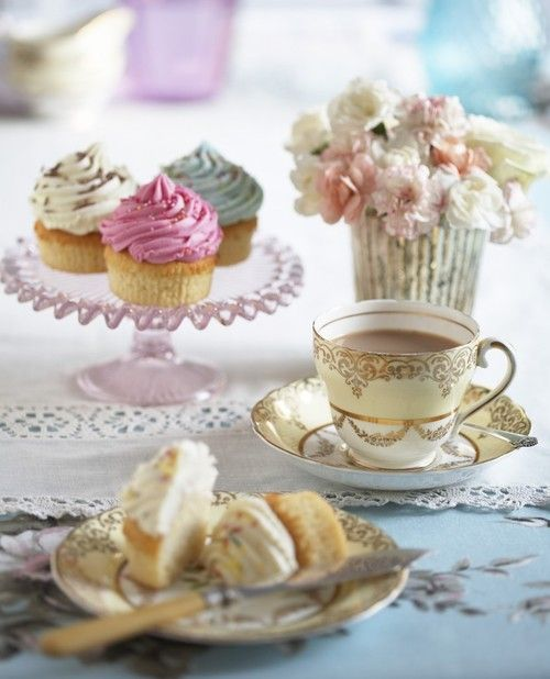 Cupcakes and tea, a classic combination.