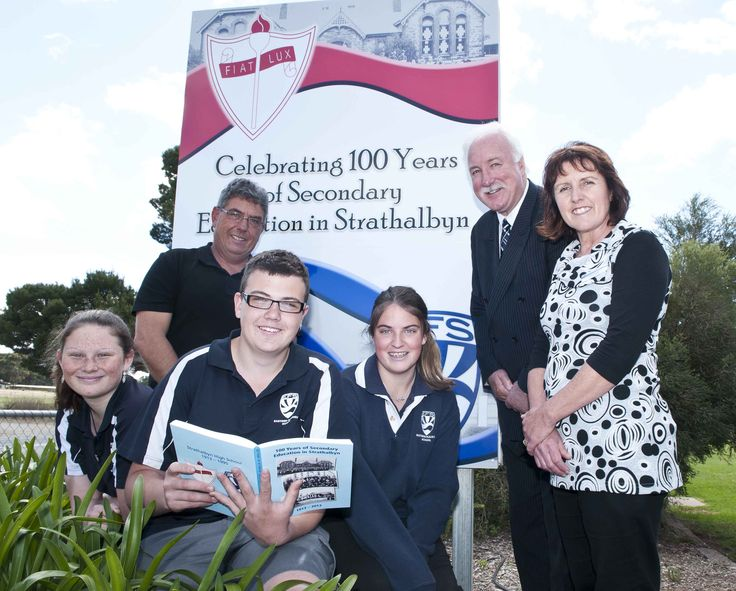 Strathalbyn High School opened its doors to 38 students on Monday, April 14, 1913 and this month they are hosting events to celebrate their centenary year. Photo: Chloe Baker, Tony Sheldon, Elijah Jones holding the school's centenary book, Courtney Burns, Principal Trevor Fletcher and Helen Wakefield. Photo by Phil Martin http://adelaidehills.realviewtechnologies.com/