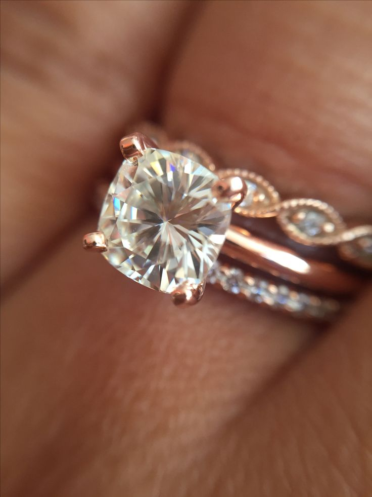 Cushion cut forever brilliant moissanite solitaire in rose gold setting
