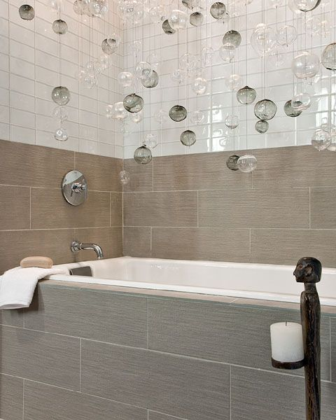 Eric Roseff Design #bathroom The Tub Is Accented By A Large Cluster Of Clear And Smoked Glass