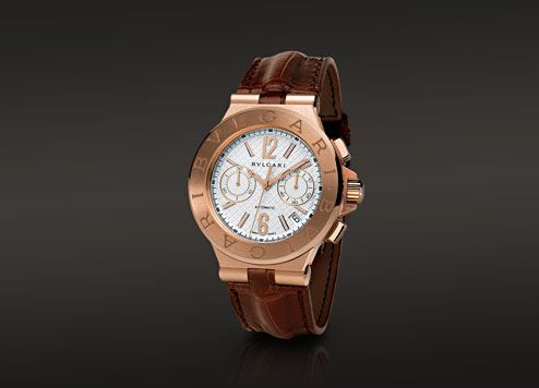 diagono chrono automatic watch with an pink gold case it features an argent dial and an alligator strap with pink gold two blades folding buckle