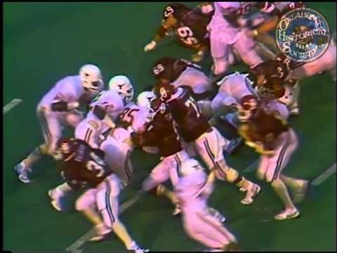 Video clips of entire game, Oklahoma vs. Texas, final score: 15-15, interview with Barry Switzer.