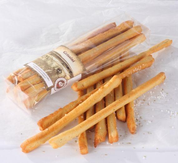 Grissini naturalne Paluszki chlebowe z mąki pszennej wypiekane na oliwie z oliwek. Samodzielna przekąska lub pyszne dopełnienie zielonej sąłatki.