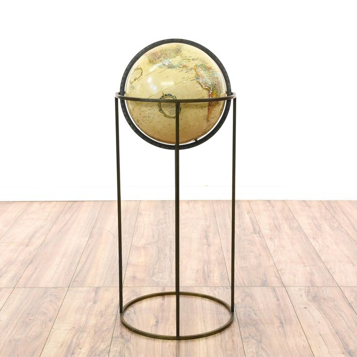 "This ""Replogle"" globe stand is featured in a durable metal with a bronze finish. This stand has a beige painted world globe with a turning swivel top and a circle base. Great for decorating an eclectic space! #americantraditional #decor #decorativeaccents #sandiegovintage #vintagefurniture"