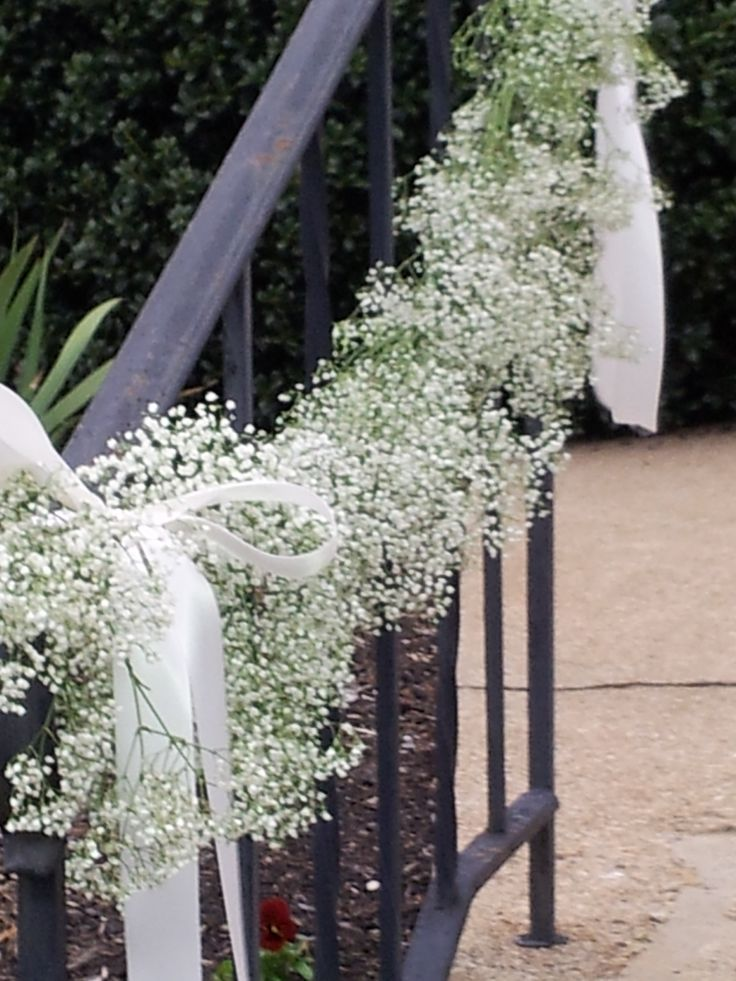 a garland made with fresh babies breath was so welcoming at this church wedding
