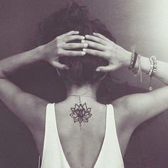 """A lotus to represent a new beginning, or a hard time in life that has been overcome and the symbol """"Hum"""" from the Buddhist mantra to stand for love, kindness and protection...this symbol is also said to purify hatred and anger.:"""