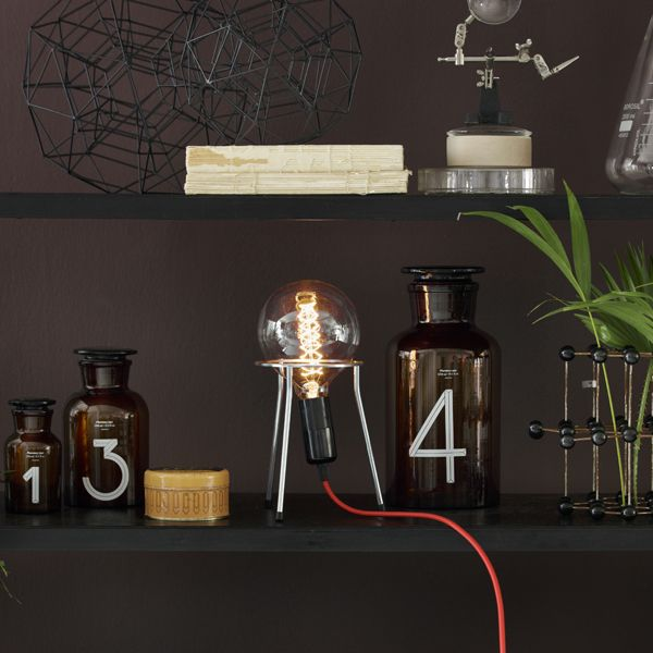 NEWTON Industrial table lamp with large globe bulb on a tripod. The components are original lab-equipment and have the flexibility and solid quality that characterizes lab-equipment.Choose between 6 different colors of cable and 2 different bulbs: S-Globe and H-Globe  Contains: 1 pc. tripod Fabric cable with switch, 3 meters ø125 GLOBE light bulb 40W  Shown with GLOBE-S bulb  Comes in a gift box  CE approved  www.kemikaze.dk  Picture credits: Eckmannstudio