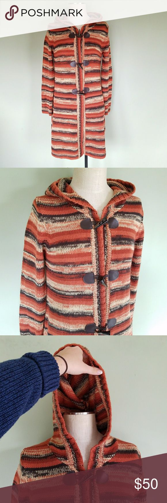 Through the Country Door Hooded Toggle Cardigan Through the Country Door brand.  Women's Medium. Relaxed fit.  Long duster cardigan sweater. Long Sleeve. Hooded. Multi Orange / Brown Striped. Toggle - faux leather closure front. Knitted. 100% Acrylic. Boho Chic, Rustic, Gypsy style.  Perfect for a colorful fall layered look.  Excellent condition! Through The Country Door Sweaters Cardigans