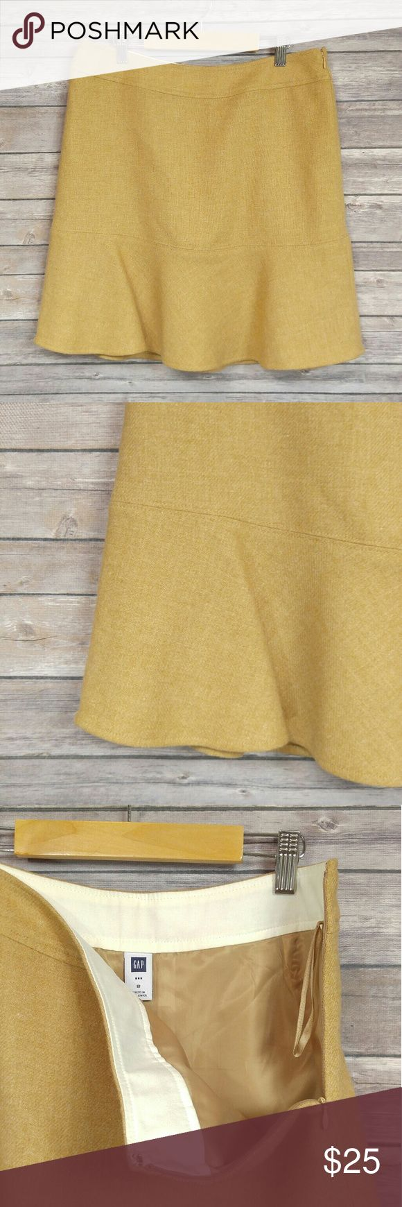 GAP tan wool trumpet skirt * Very fall like skirt * Wear with tights and a pair of Oxford heels * Zipper closure on side * Trumpet shape skirt * 90% wool 10% nylon, 100% polyester lining * Dry clean * Waist: 16 in. * Length: 20 in. GAP Skirts