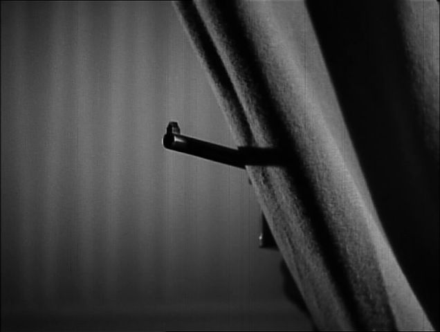"A Mauser ""Broomhandle"" gun comes out from behind the curtains in the first ""39 Steps"" movie by Alfred Hitchcock."