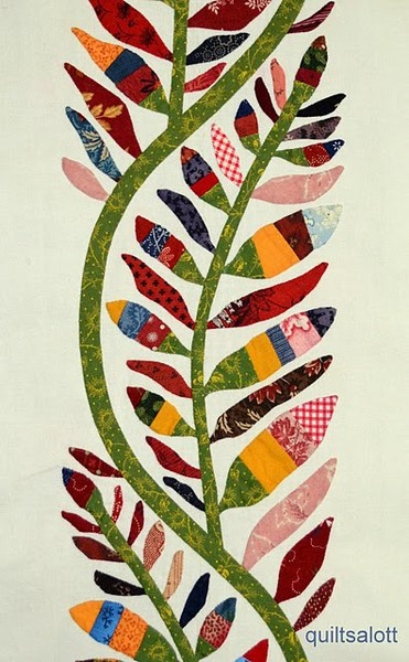 Love the way the leaves are made from strip pieced fabrics. Leaves don't have to be green.