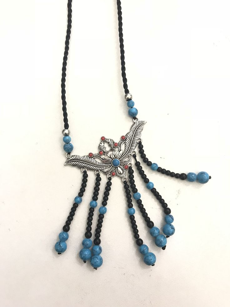 Pendent with silver and turquoise beads