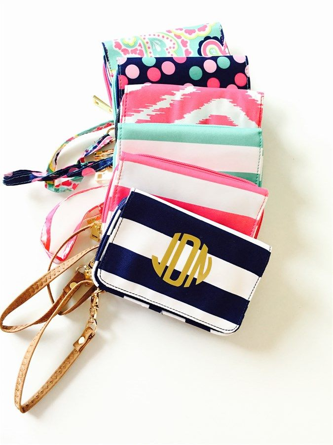 "Super Cute Monogram Wristlets in  6 fun patterns! Great for having all your essentials with you while you shop, work out, or having a night out on the town! 6.5"" L x 1.5""W x 4""HPolyesterSnap PocketZipper ClosureZipper Change PocketCard HoldersClear ID WindowPhone pocket (will not accommodate an iPhone 6+)Classic monogram will be gold on the navy, pink, and mint striped wristlet.Classic monogram will be in white on the confetti wristletClassic monogram will be in navy..."
