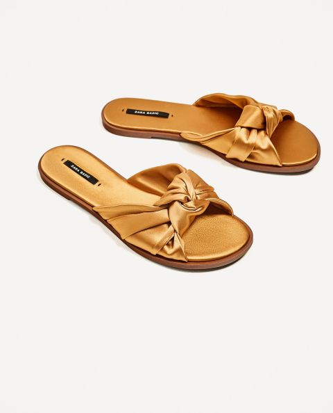 Amp up your workplace attire with these satin bow slides from Zara.
