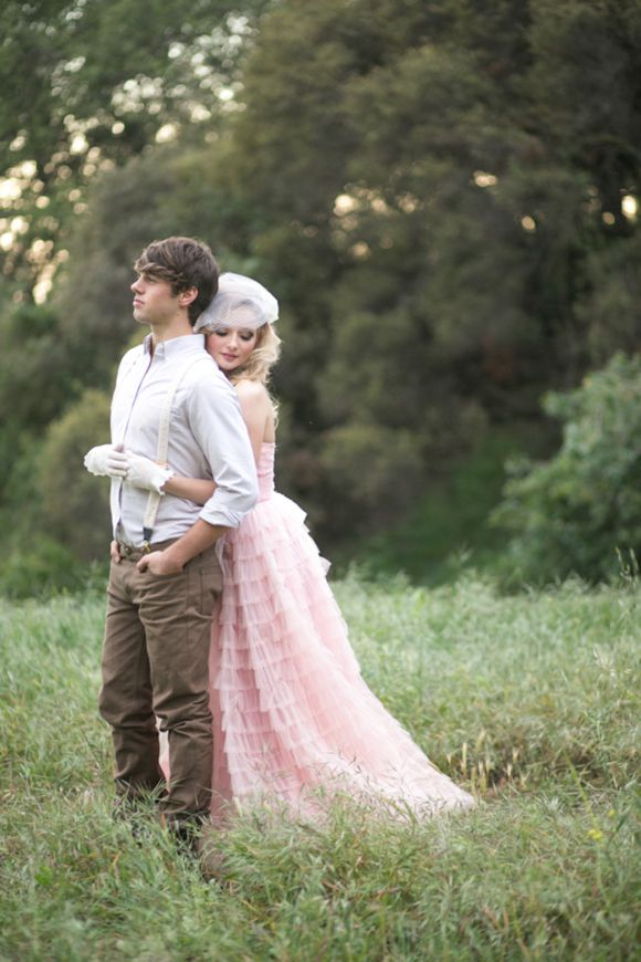 Vintage wedding dress in pink tiered tulle and pretty birdcage veil Photos by @Kristen_Booth