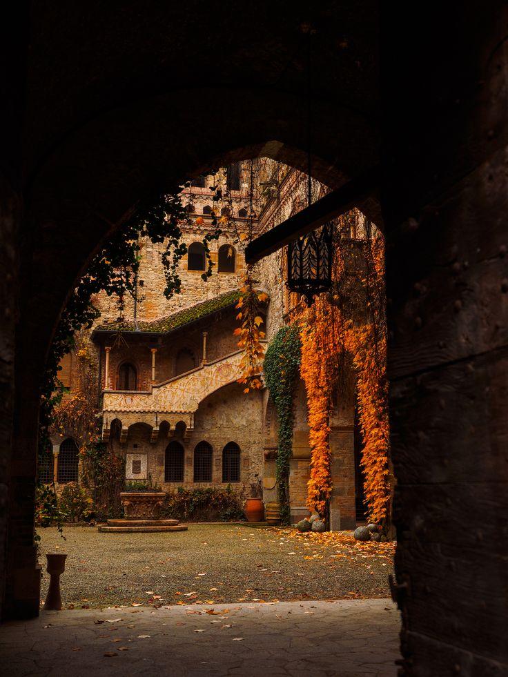 autumn courtyard at the castle of grazzano visconti, piacenza italy