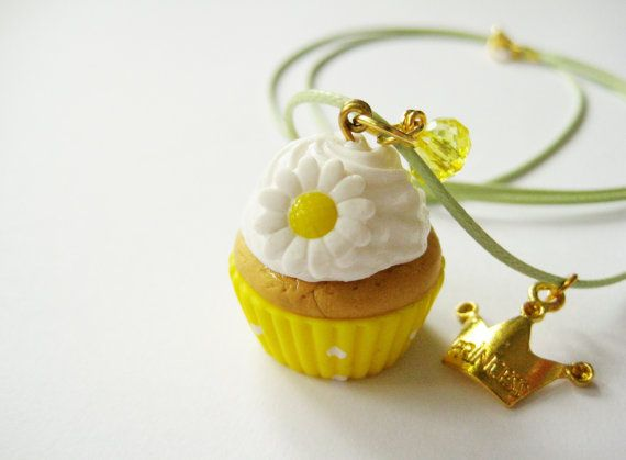 Handmade yellow cupcake necklace with a yellow plastic bead and a gold plated crown