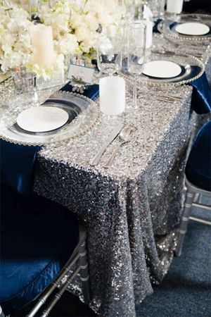 Love the silver sparkle and deep blue color palette for a winter wedding!