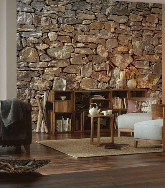 A parede com pedras traz um ar clássico e sofisticado, sendo uma ótima opção para deixar a sala mais aconchegante. O painel fotográfico de pedras é uma ótima opção para criar esse ambiente na sala, deixando uma decoração rústica.