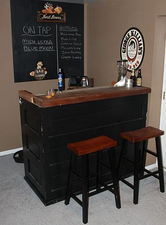 What is a man cave without your own personal bar! Use recycled old doors to recreate this basement bar