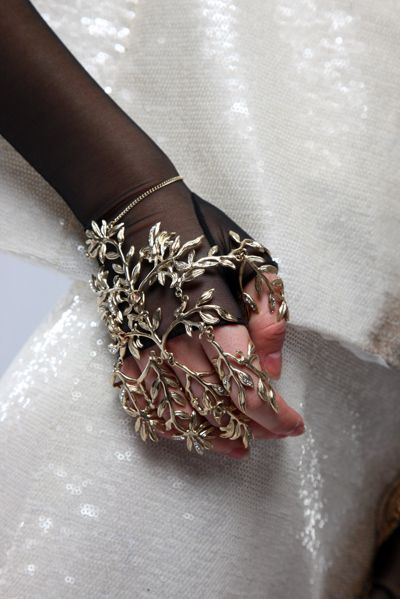 bracelet, fashion, gloves, gold, hand; neat concept, pretty... but I can only imagine getting my hand snagged/hung up everythime I moved!